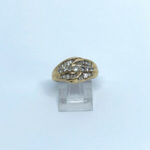 yellow gold fourteen karat round brilliant and tapered diamond baguettes approximately one carat total weight