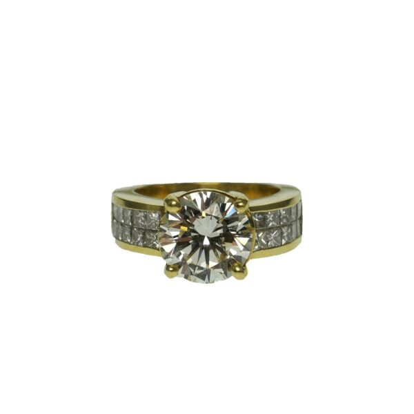 yellow gold eighteen karat engagement ring with round brilliant diamond weighing approximately three point twenty carats and twenty invisible set princess cut diamonds weighing approximately zero point zero six carats each