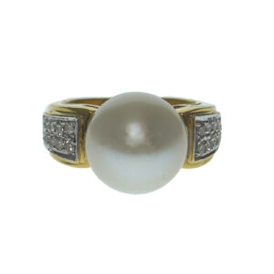 ladies yellow gold eighteen karat two toned setting with one cultured pearl approximately twelve point eighty eight millimeters and twenty round brilliant pave set diamond chips