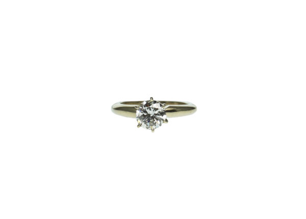 white gold fourteen karat six prong solitaire setting engagement ring with round brilliant diamond one point ten carat weight