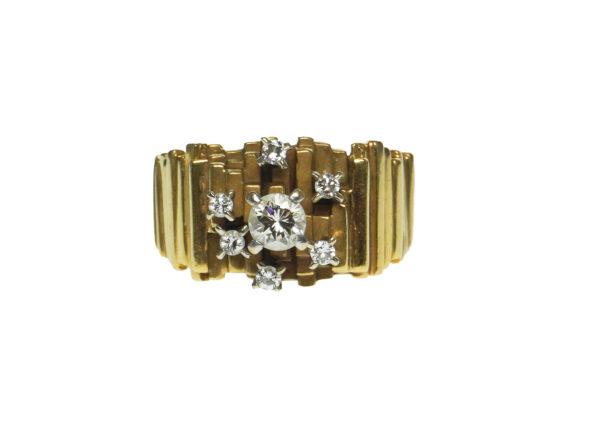 yellow gold eighteen karat asymmetrical tubular mid century modern design with one brilliant round diamond approximately zero point twenty five carats and six round brilliant diamond chips set in four prong setting