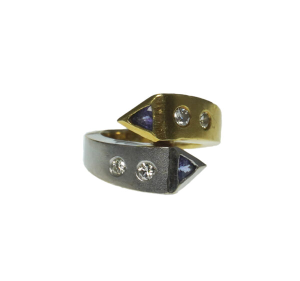 ladies yellow and white gold eighteen karat with two trillion cut tanzanite gemstone ring with four brilliant cut diamonds approximately zero point sixty four total diamond carat weight modern design