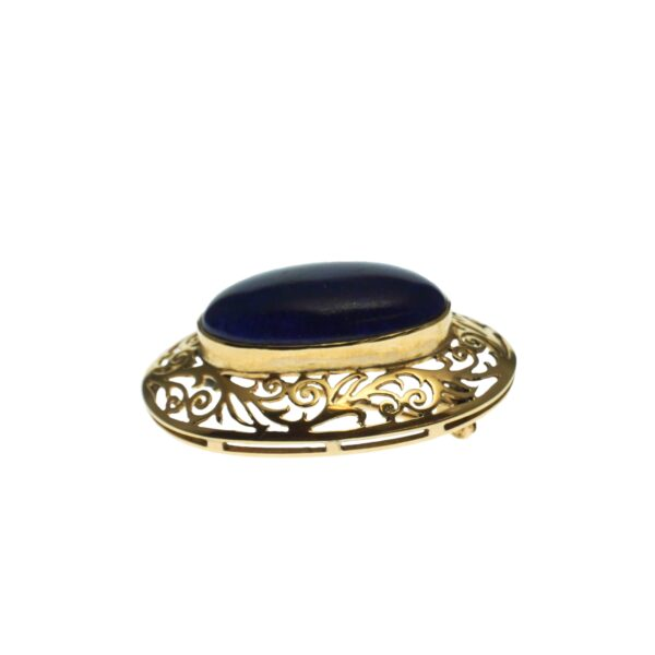 yellow gold fourteen karat cabochon oval shape lapis lazuli in filigree open artwork mounting with c style silver tone clasp