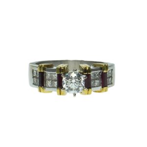 engagement style white gold eighteen carat with yellow gold enhancers center round brilliant cut diamond zero point ninety carats sixteen princess cut diamonds approximately zero point ten carats and four red stones