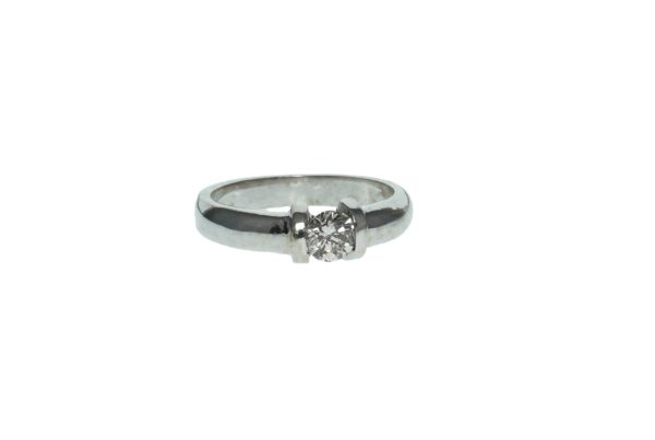 ladies white gold fourteen karat band with round brilliant diamond approximately point sixty five carats