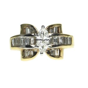 yellow gold fourteen karat setting engagement ring with center marquise cut diamond approximately zero point forty five carats fourteen baguette diamonds approximately zero point zero six each and four baguette diamonds approximately zero point zero three carats each