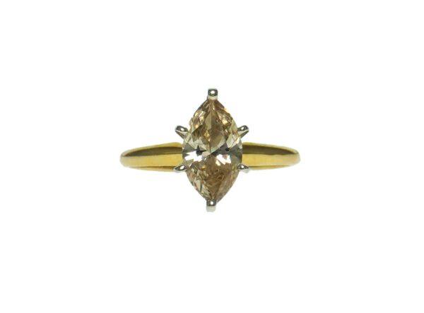 yellow gold fourteen karat solitaire engagement style setting with fracture filled marquise cut diamond approximately two point zero zero carats