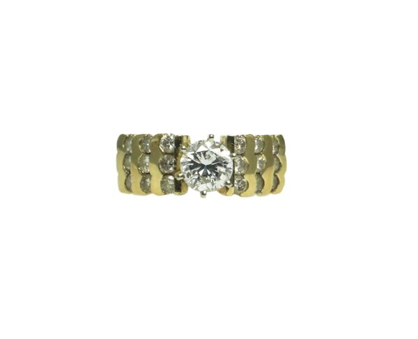 ladies yellow gold fourteen karat engagement ring with center set round brilliant cut diamond one point twelve carats and eighteen round brilliant cut diamonds approximately zero point zero five carats