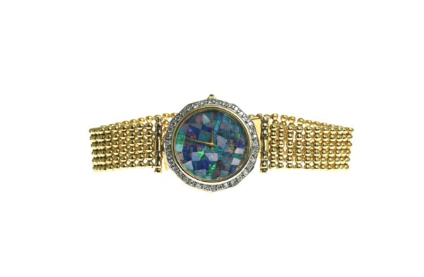 men's yellow gold eighteen karat case and band watch black opal round dial with approximately thirty eight round brilliant cut diamond chips on bezel beaded style band with approximately twenty round brilliant cut diamond chips and blue cabochon stone on crown with a deployment style clasp