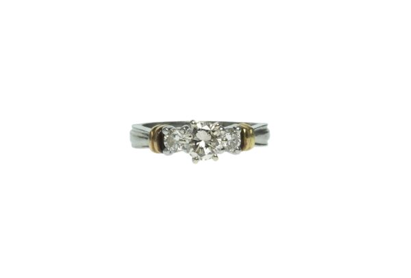 ladies platinum setting engagement ring with marquise shape center diamond approximately zero point eighty carat and eighteen karat accents with two round brilliant cut diamonds approximately zero point twenty carat each