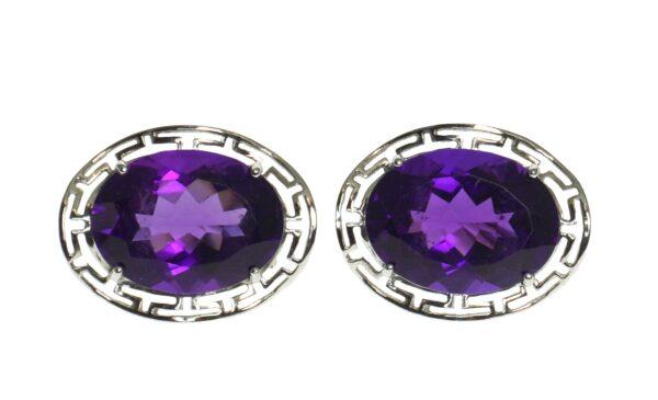 white gold fourteen karat oval amethyst earrings set in four prong enhanced by greek key pattern oval halo