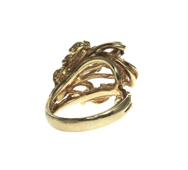 ladies yellow gold fourteen karat ring with five round brilliant red stones set in an open work mounting