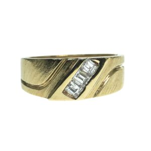 ladies yellow gold fourteen karat wedding band style ring with three channel set baguette cut diamonds approximately zero point fourteen each with grooves on each side