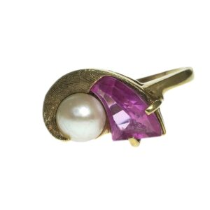ladies yellow gold fourteen karat with a tapered trapeze cut pink sapphire with a cultured pearl