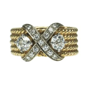 yellow gold fourteen karat rope design cigar style band with an x in middle set with thirteen round brilliant cut diamond chips flanked by two mine cut diamonds approximately zero point forty carats on sides