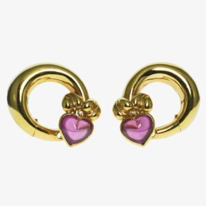 yellow gold eighteen karat clip style with post swirl hollow design with heart shaped pink gemstone heart on each