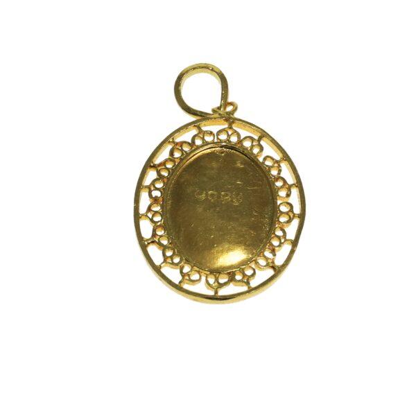 chinese longevity shou symbol charm yellow gold twenty two karat gold with detailed ornate bezel surrounding