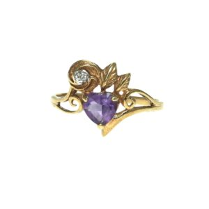 yellow gold fourteen karat fashion ring with heart shaped light purple gemstone and round brilliant diamond chip in a nature inspired design