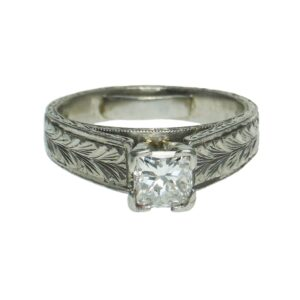 platinum solitaire nature engraved design mounting with four prong set princess cut diamond weighing approximately zero point seventy five points and inner shank ring size adjuster